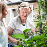 an elderly lady with dementia in her garden